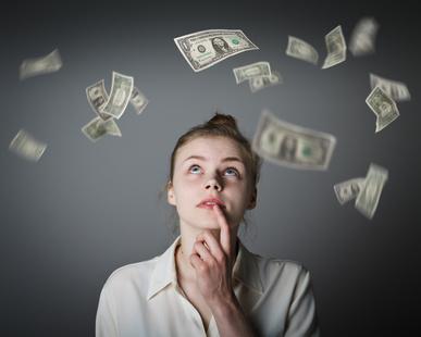 "Bild ""Girl in white and dollars."" von Marijus bei Fotolia"