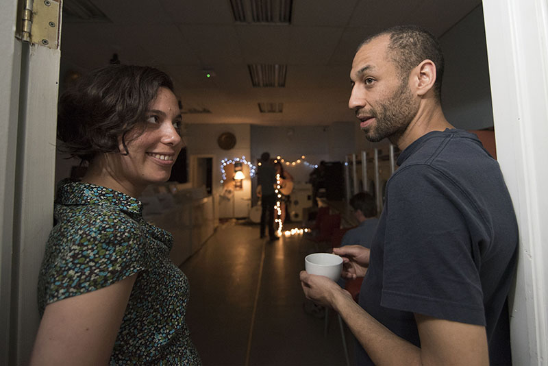 Downtown Diggs:  Nicole Dyble and Sam Decter weren't put off by the poor reputation of Gore Street when looking for a home and then starting a business. The couple look on as Mark Dunn performs in the laundry matt in the rear of the Cafe Friday July 3, 2015.