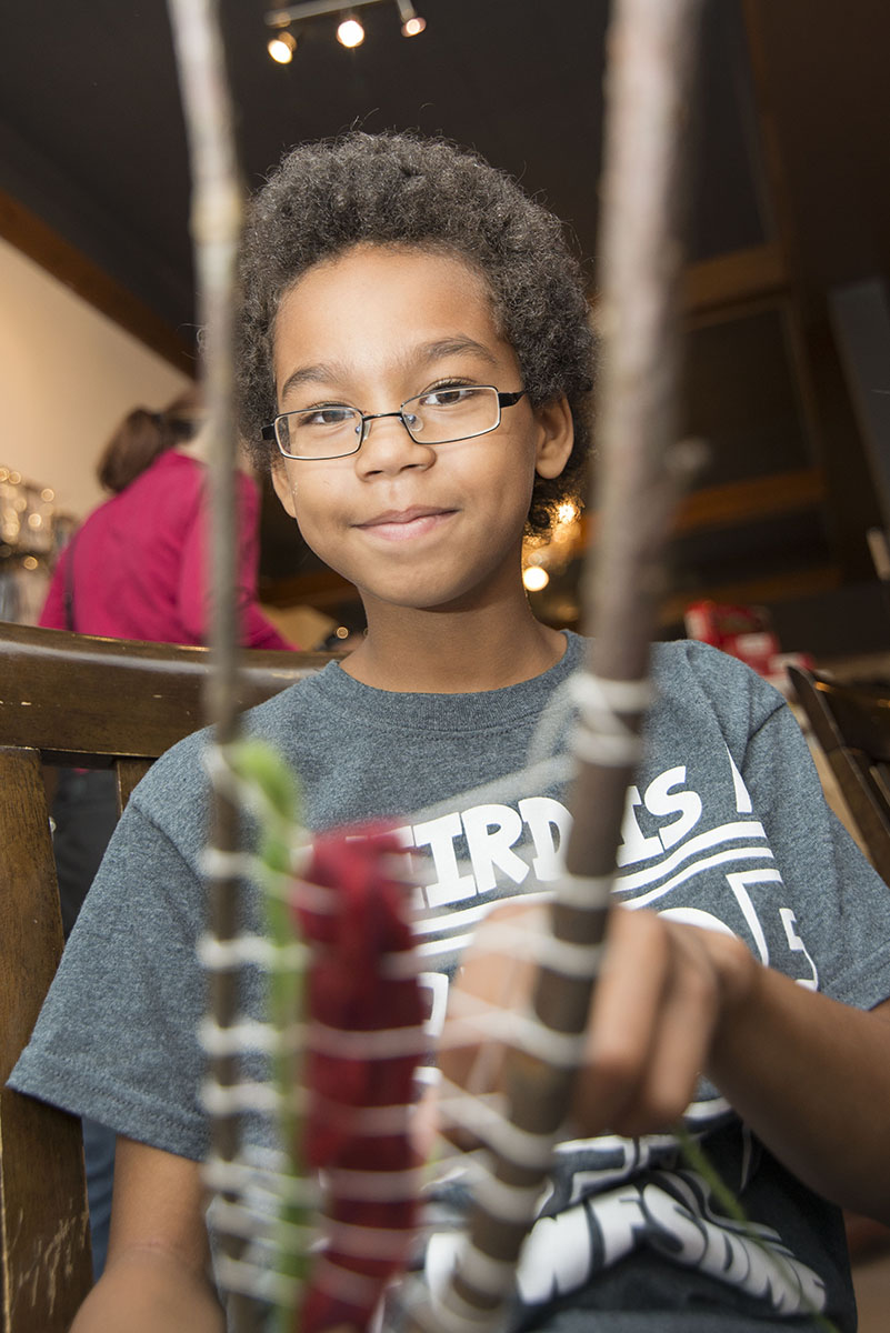 End Of Summer Fun:  Isaiah McGregor, 9, tried his hand at branch weaving at Shabby Motley, Saturday August 29th, 2015 during the Back-To-School Carnival.