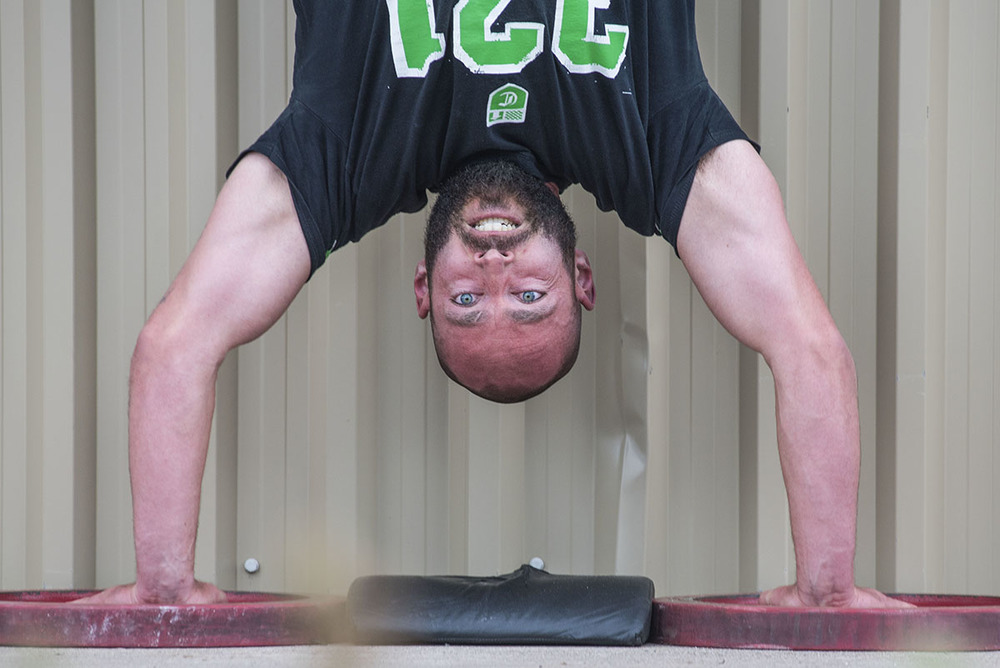 Big Push:  Tyler Belanger does a hand stand pushup during the Catalyst Games at Runway Park Saturday September 19th, 2015.  Every year the Catalyst Games selects the fittest man, woman and team in Northern Ontario, through a series of events that test endurance, stamina, accuracy, strength, power and agility.