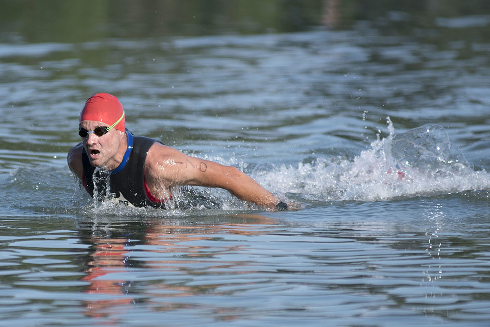 Michael Stirling completes the swimming portion in the Sprint Triathlon  placing 2nd overall and 1st in category male 40-49 with a time of 1:09:44, Saturday  August, 15, 2015, on St. Joes Island.