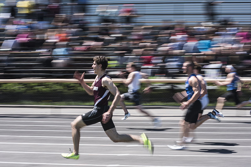On The Right Track:  St. Mary's student Zack Senecal in the lead part way through the Senior 100m dash, finished in second to Colton Read of St. Basils, Thursday afternoon.  Local students competed at the City Track and Field Championships at Jo Forman Track.