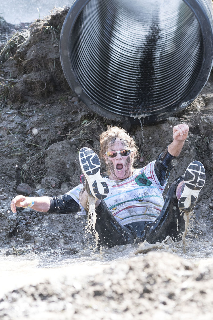 Op-Mud-Tistic:  Daisy Beach Lands in a pool of muddy water at the bottom the of the tube slide obstacle SaturdaySeptember, 12, 2015, at Searchmont during the Muddy Moose Charge.  This second annual Canadian Cancer Society Event event brings the community together to raise money for promising childhood cancer research and vital support services.