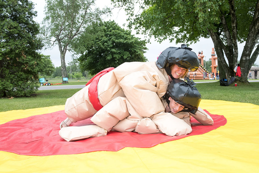 Sumo Spectacular: Sharilyn VanScoy takes down Ashton Brooks during a Sumo Wrestling match just one of the fun options during the Big Picnic at the Sault Ste. Marie Canal National Historic Site of Canada, Saturday June, 24th,2017.