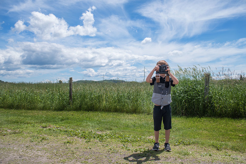 Photo Photo: A young photographer, takes focus on the photographyer during an event at the town hall in rural Bar River Saturday June 24th, 2017.