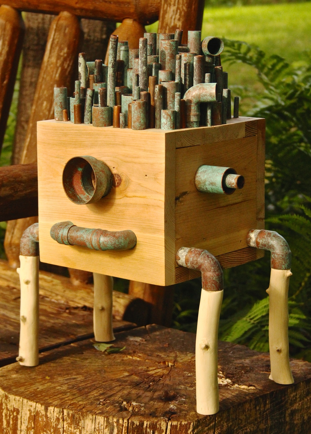 Copper Top was created from recycled wood, copper pipe and pieces and apple tree branches