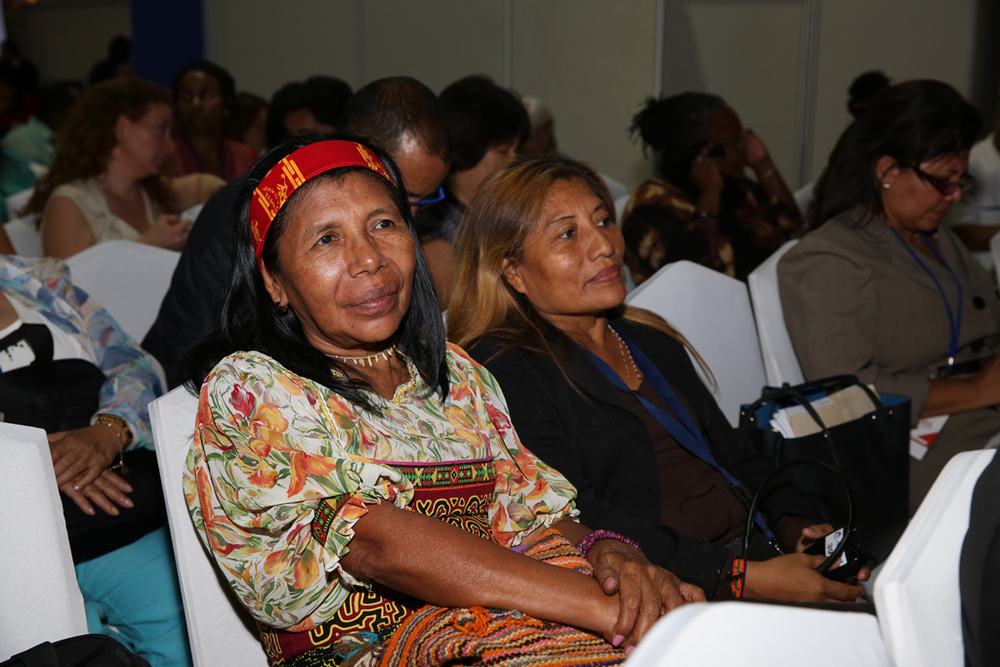 A woman listens to the speeches at the opening ceremony of the forum.  (Credit: Cumbre Panamá)