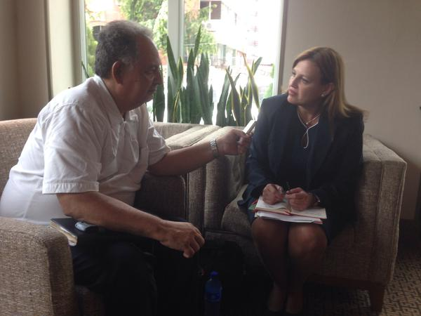 PADF Senior Programs Director Caterina Valero with a reporter ahead of the Summit of the Americas in Panama.