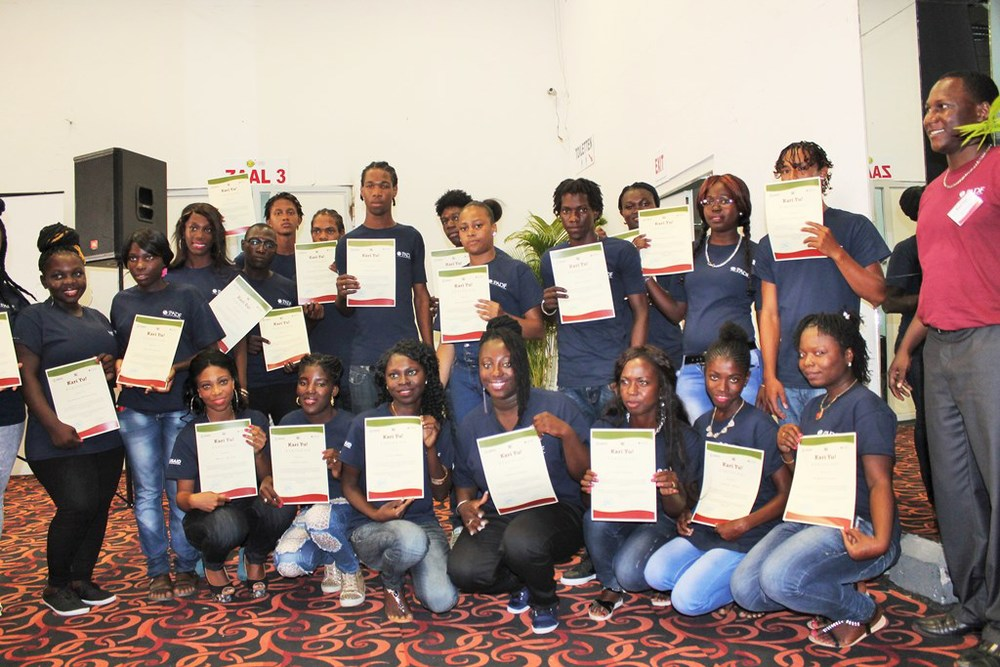 Graduates display certificates from a five-week course in life skills and employment training.