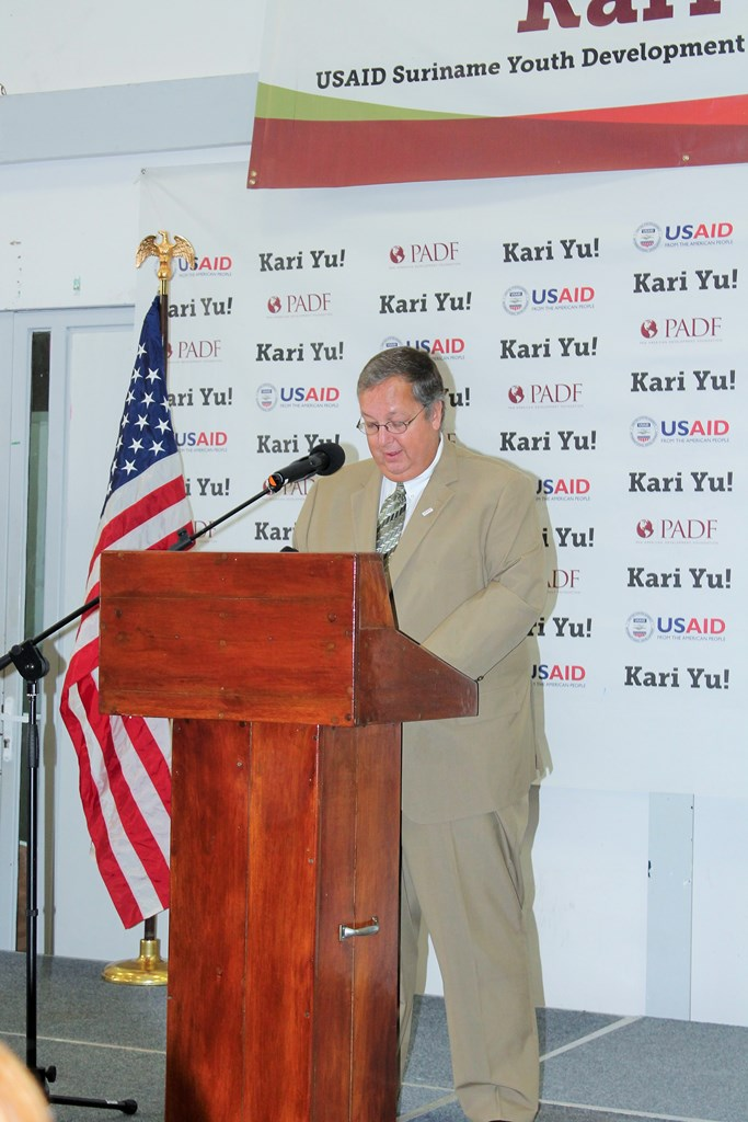 USAID Mission Director  Christopher Cushing gives remarks at the graduation.