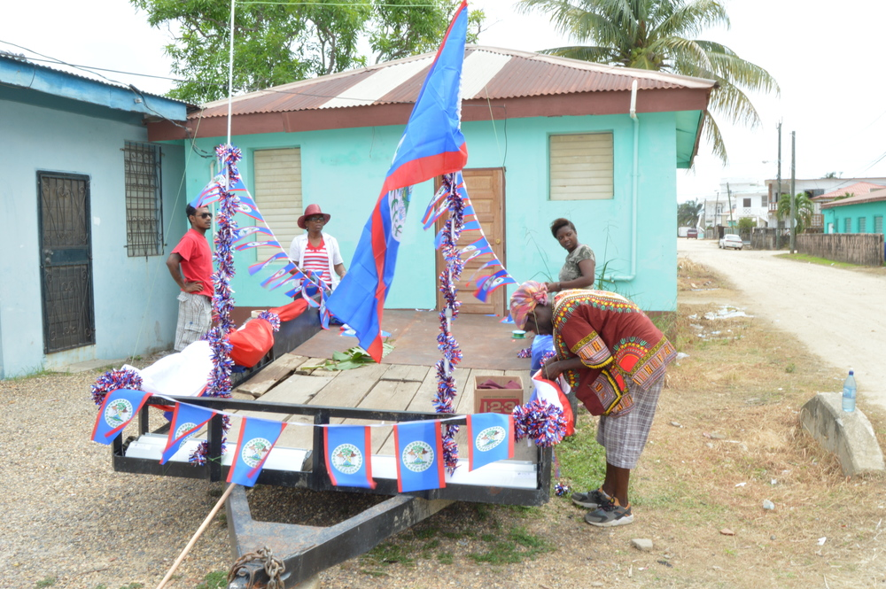 PADF staff decorate the float for St. George's Caye Day Parade
