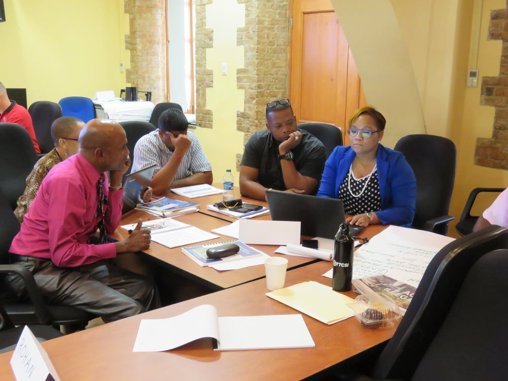 Sharon Francis-Gaines (right) works with a group to create an action plan at RAPP accreditation training in October 2015.