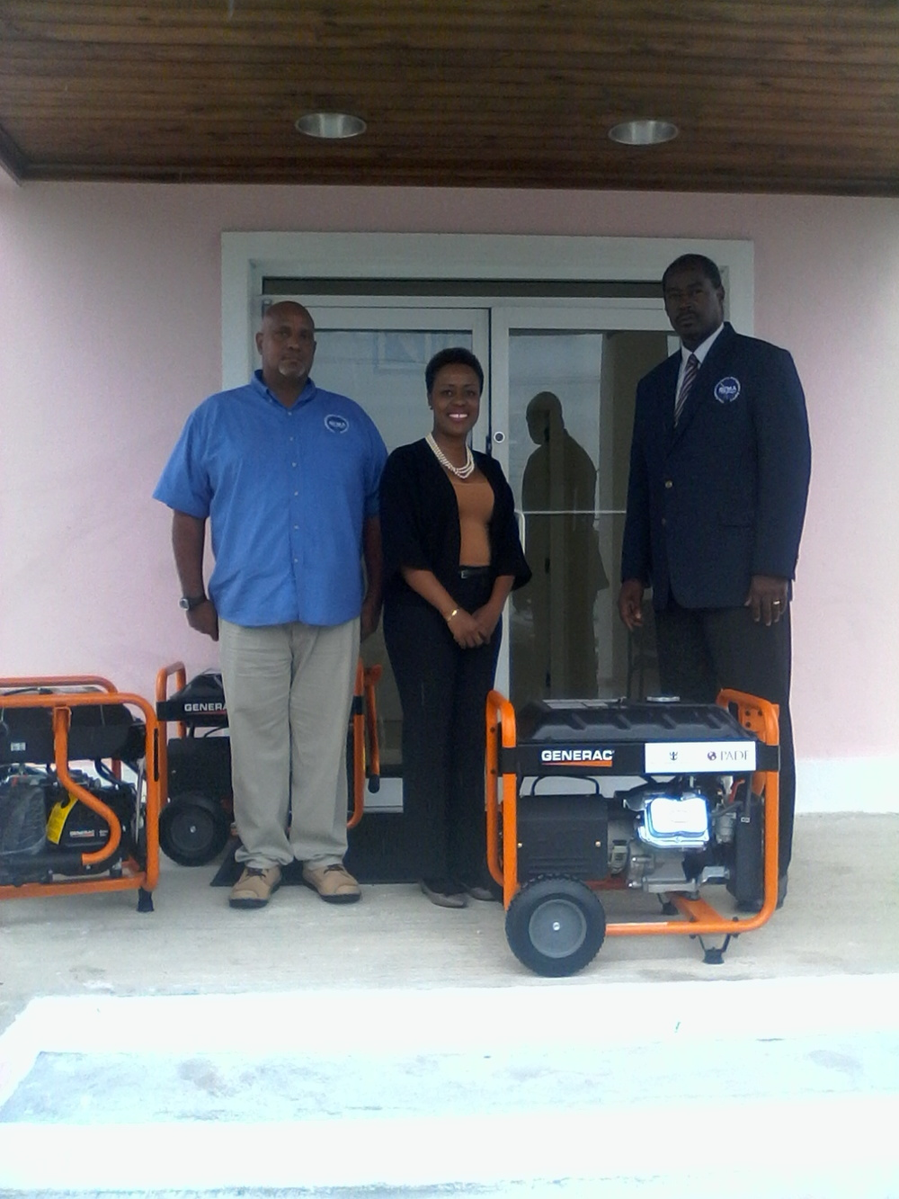 Charo Morley presents household generators to Director of NEMA Bahamas Captain Stephen Russell on behalf of PADF and Royal Caribbean.