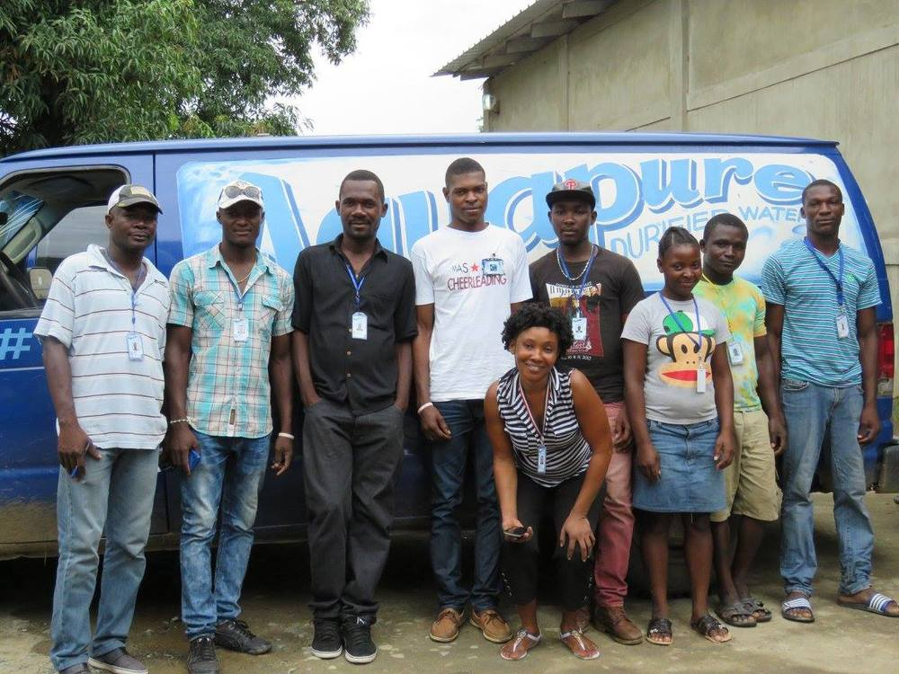 CASTMI employees pose in front of the delivery van.