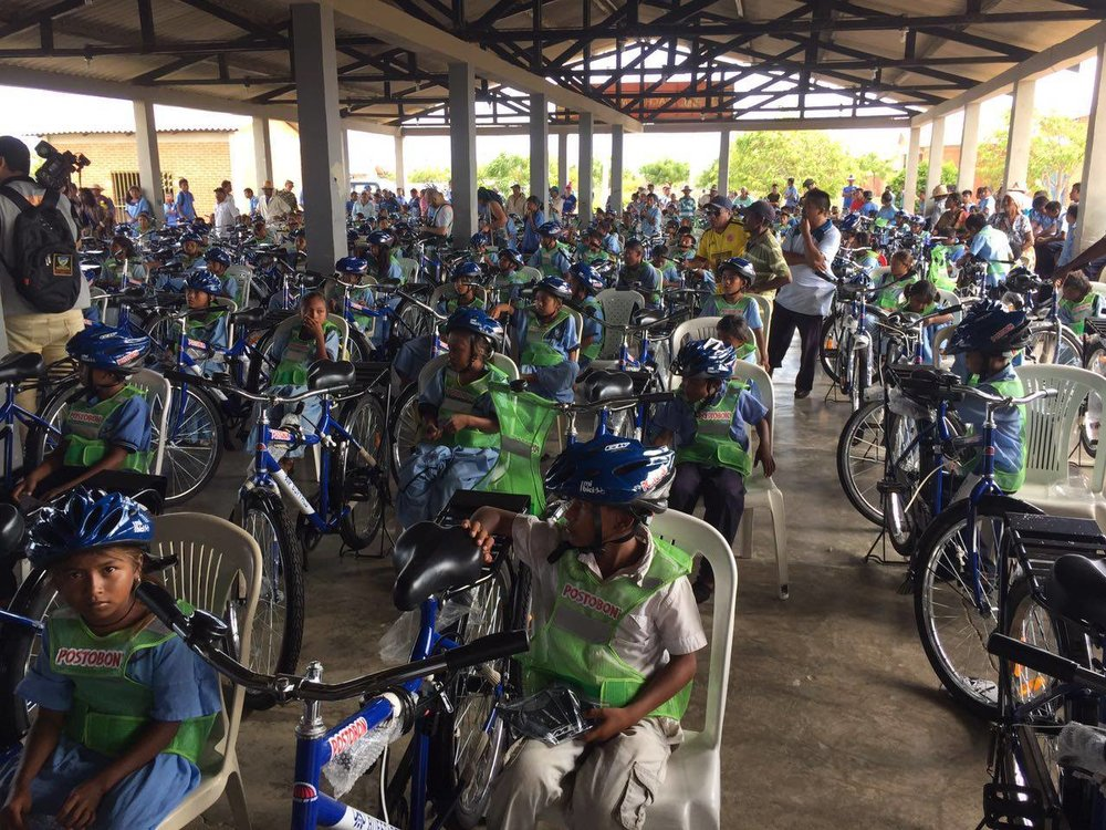 Kids from the Rural Ethnoeducation Institute in Samutpio receive their bikes.