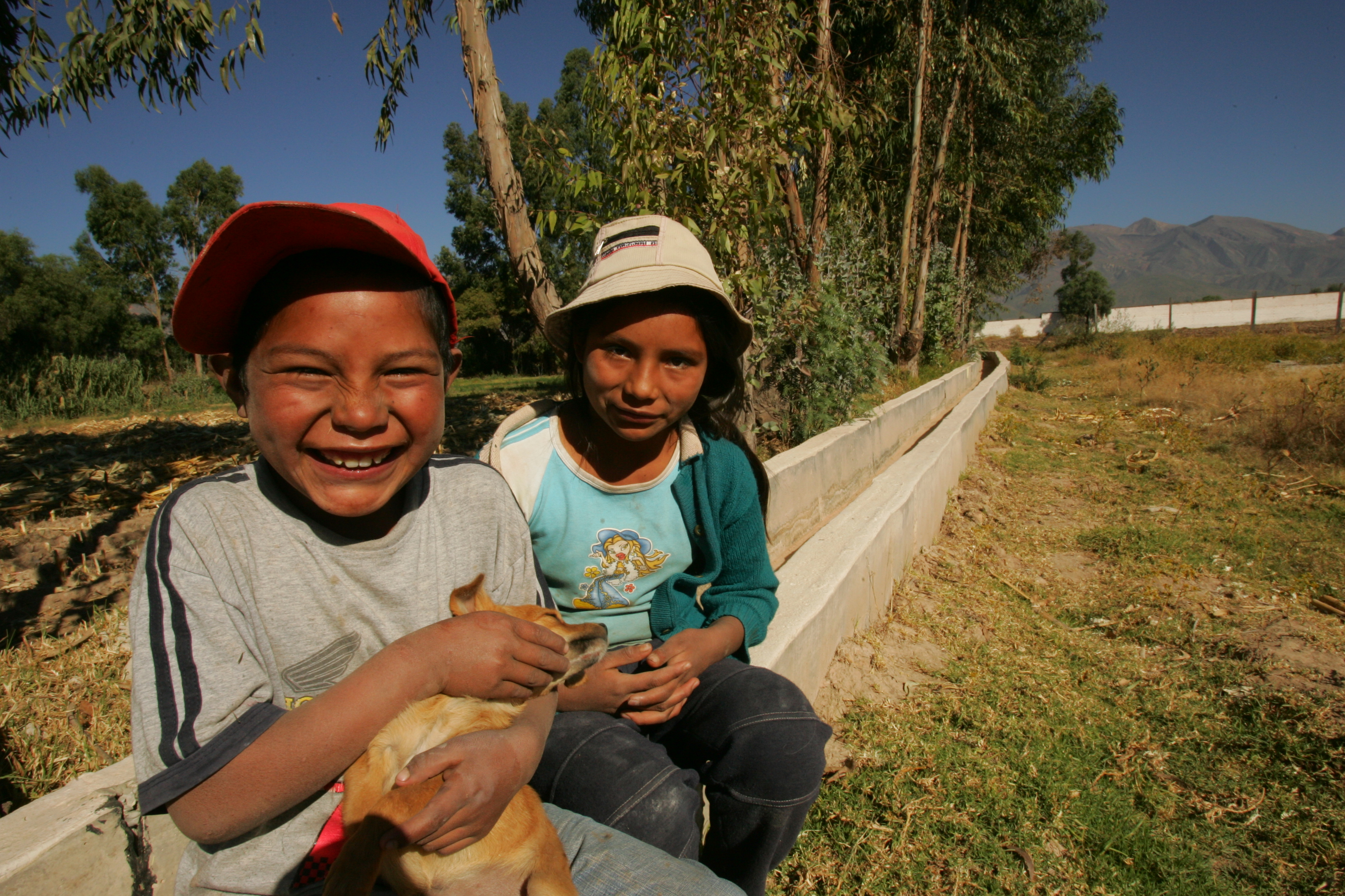 kids on irrigation canal.jpg