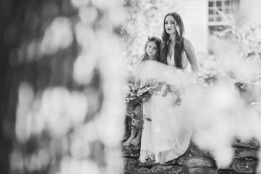 I have always loved black and white photos. These are from the Love-N-Lavender shoot and they take my breathe away. Sitting on a stone wall, Janna and Brealynn look timeless.   Photography by : Lea Nicole Photography  Flowers by:  LeRae Events and Design
