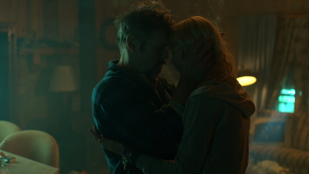 Brock (Bill Sage) comforts Peggy (Sabina Gadecki)