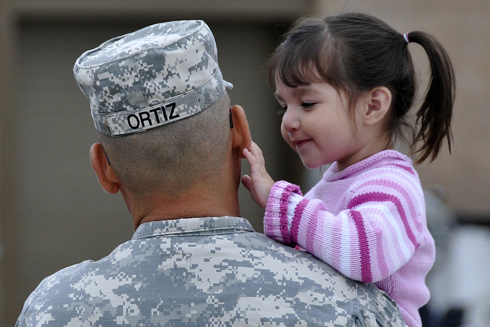 Khloee Ortiz smiles at her dad Staff Sgt. Cesar Ortiz just before his departure to Afghanistan in 2011. Source
