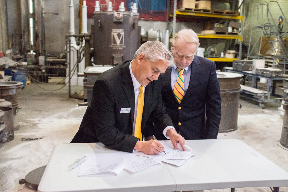 Foundation Executive Director Lou Olivera and Verdin president Jim Verdin sign the contract for Verdin to cast the Honor Bell.
