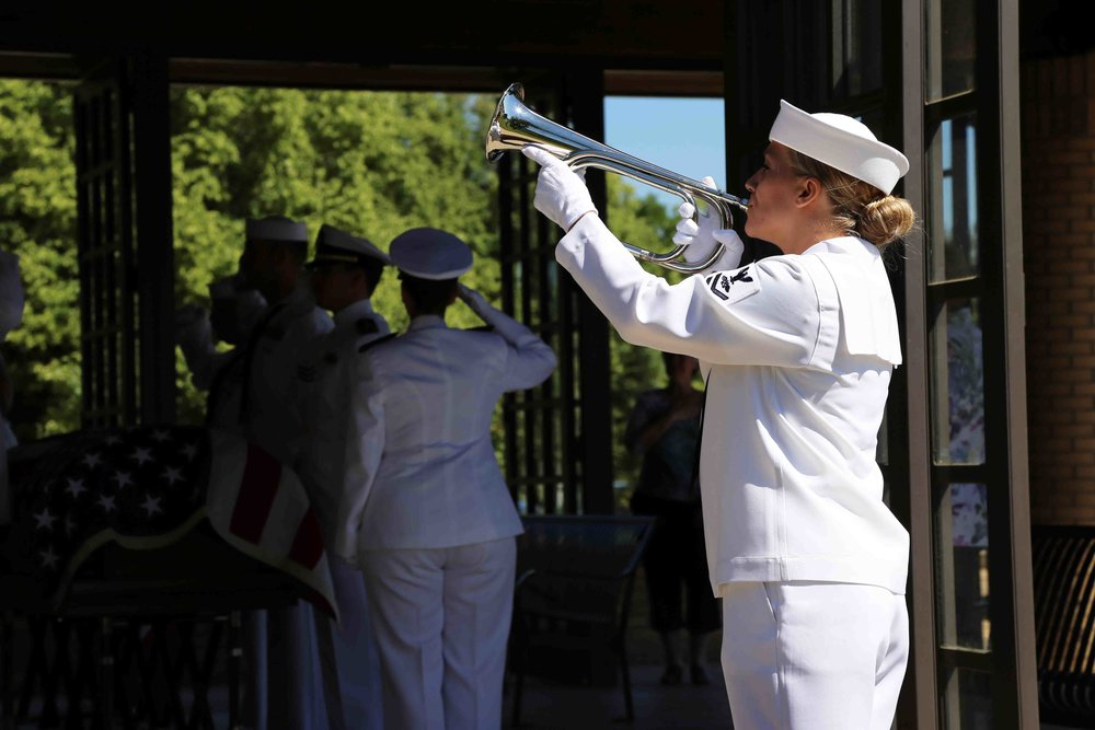 A member of the Navy Honor Guard plays taps. Photo courtesy of Erick Stowe.