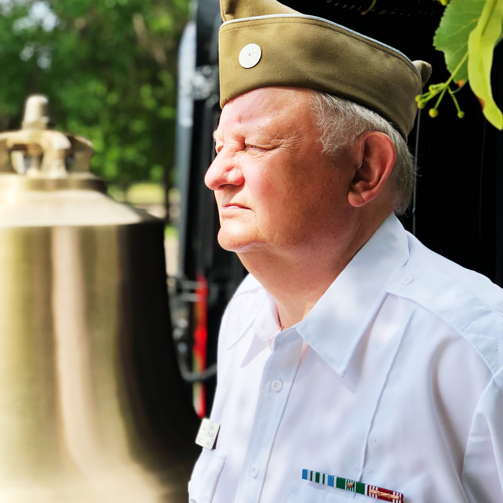 Vietnam veteran Denis Spelman does double duty at Fort Logan by volunteering at the Public Information Center and tolling the Honor Bell.