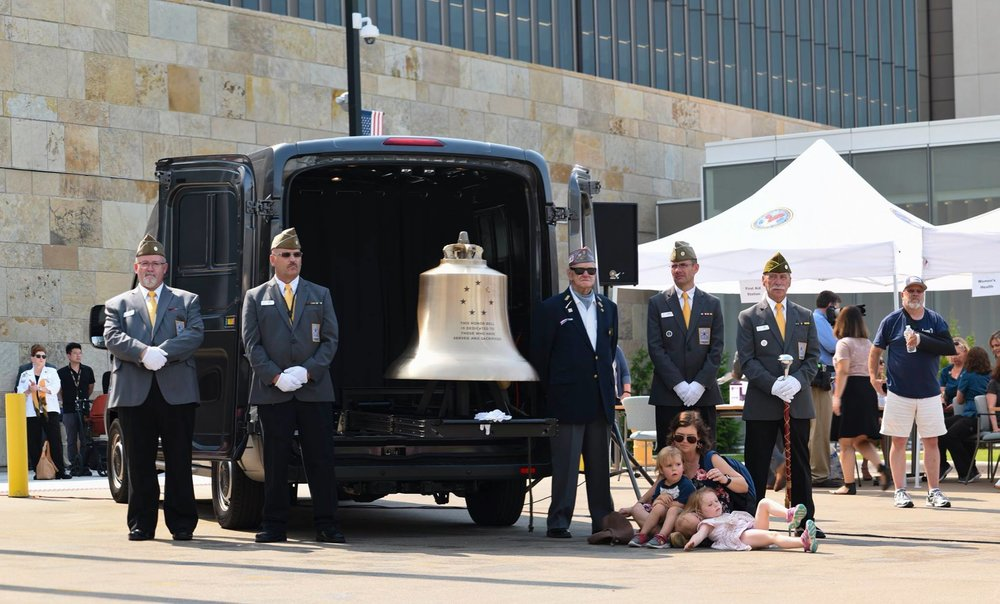 The Honor Bell and Guards at the new VA Center. From left: Bell Guards Dean Brown and Tracy Turner with Christopher Nielsen, and Bell Guard Greg Kuhn.