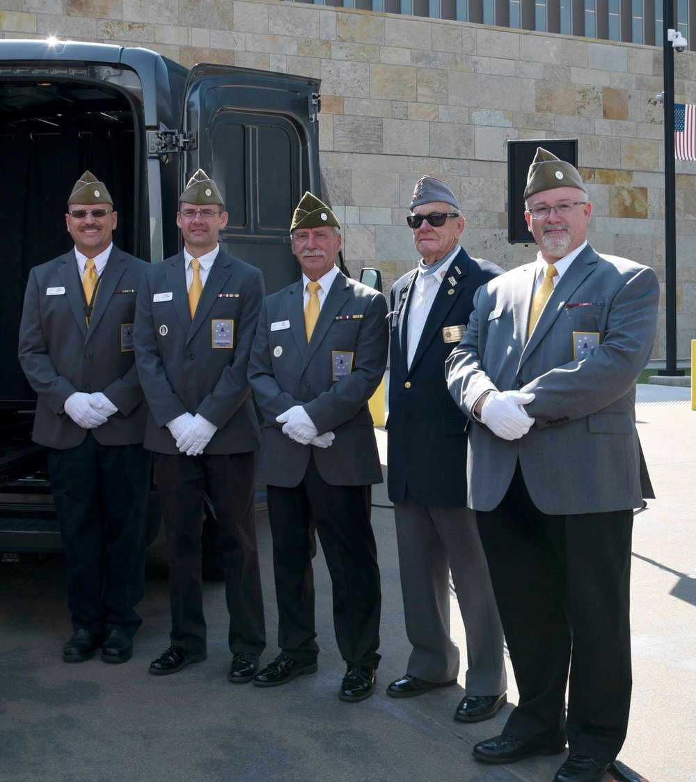 Bell Guards Tracy Turner, Daniel McCutchon, and Greg Kuhn with Christopher Nielsen and Bell Guard Dean Brown.