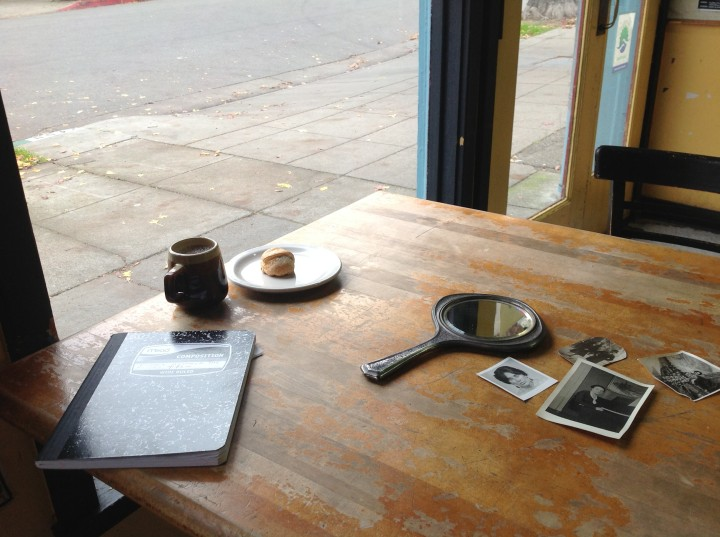Photos and notes are spread out on a table at Nabolom Bakery in Berkeley, where Moira Roth spent time composing her experimental narrative. KunstWorks was recently awarded a grant to transform the project into a publication.
