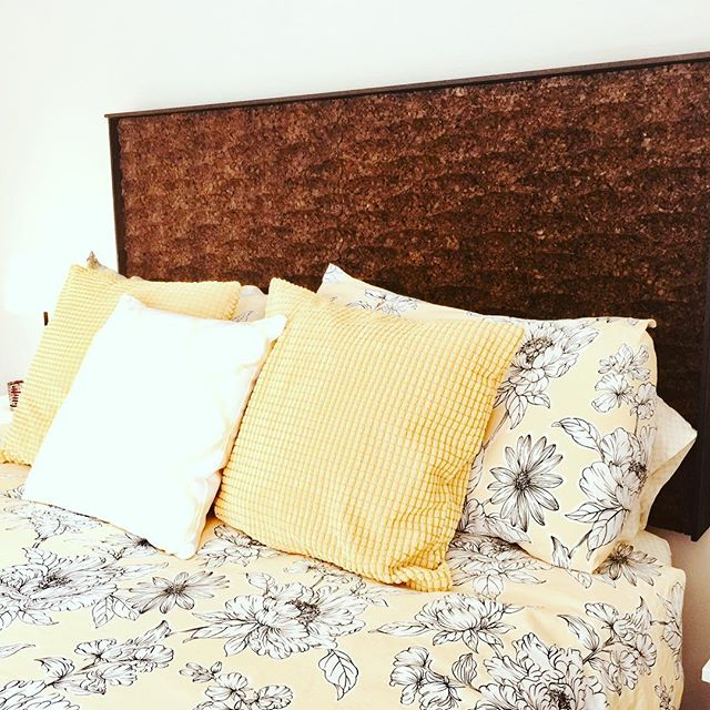 "This is a home-made headboard for our bed.  Made with 2"" ThermaCork, wave pattern and trimmed with black painted wood and attached to our bedroom wall.  Took a few hours to make, one week-end afternoon.  Comfy and easy! #Thermacork #doityourself #cork #furnituredesign"