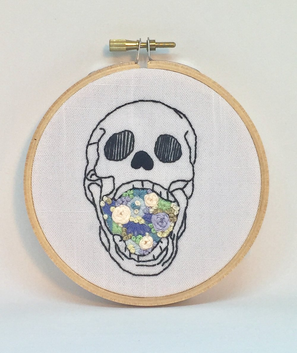 Skull with flowers in mouth embroidery hoop