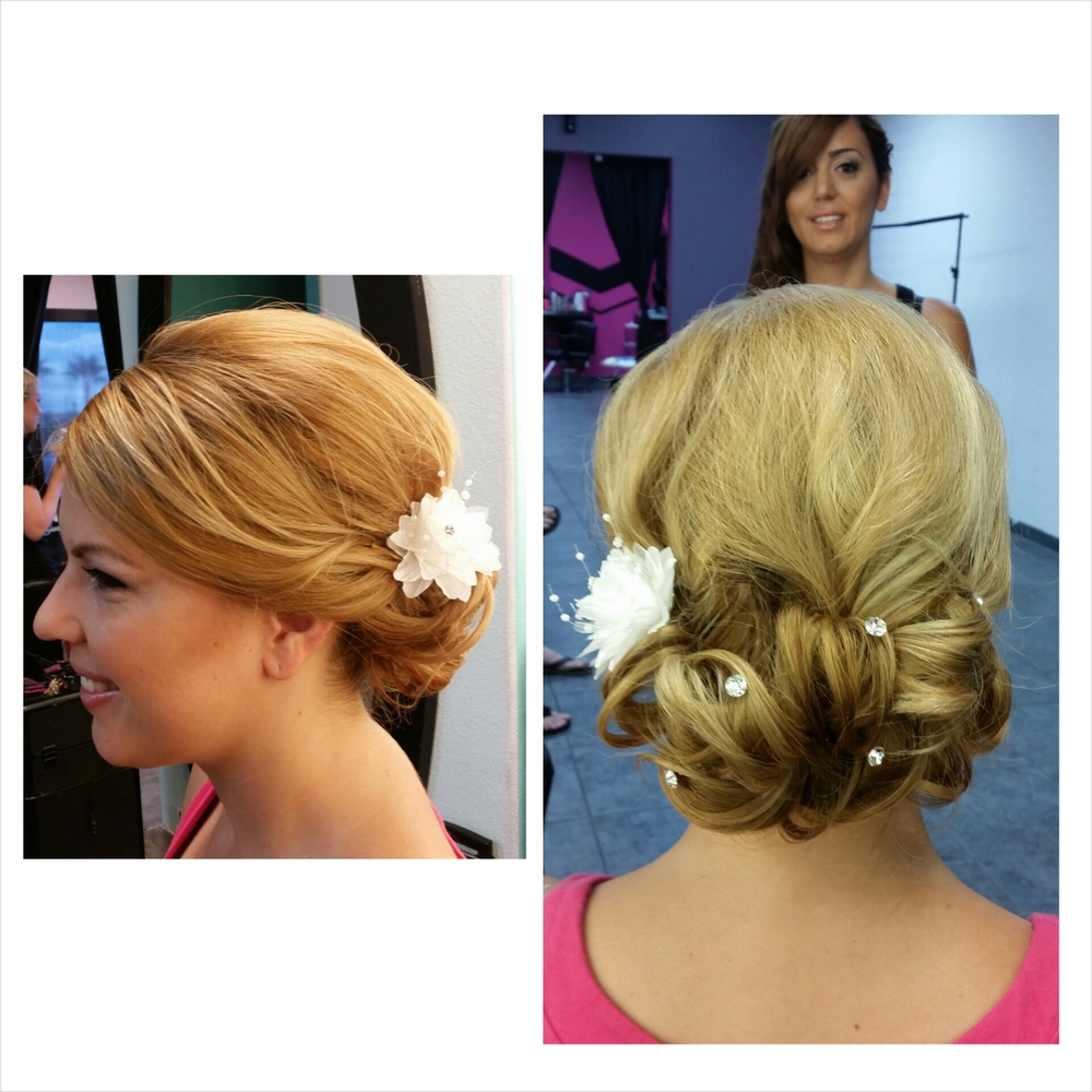 This is a classic elegant look great for adding accessories to. This bride's hair is actually a long A-line. The back of her hair only reaches just above her shoulders.  Hair texture needed: Medium to thick Hair length needed: All Types Recommendations: Having the curled bun low at the nape gives the opportunity for shorter hair to look longer and thicker.