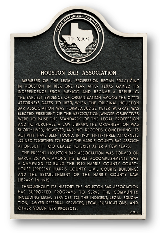 "Texas Historical Commission Plaque, ""Houston Bar Association,"" standing outside the Fannin Street entrance of the 1910 Courthouse in downtown Houston."