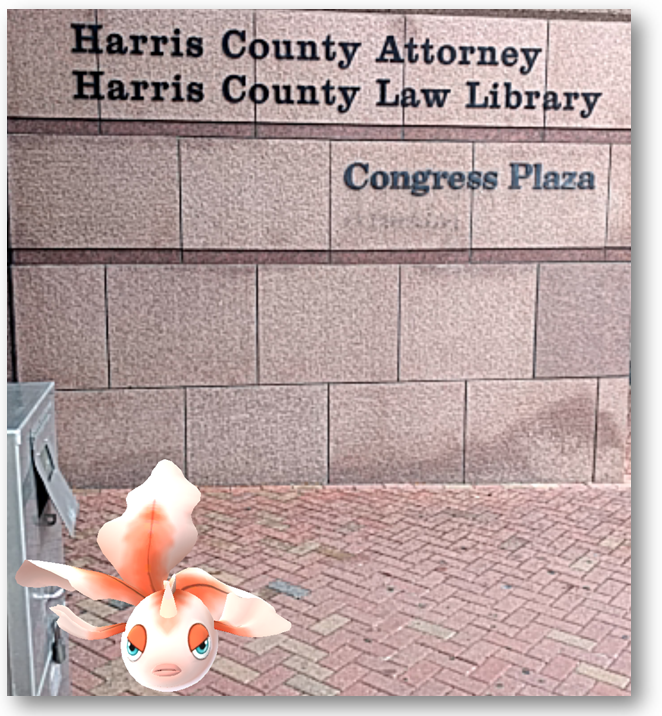 A Goldeen splashing around outside the Harris County Law Library