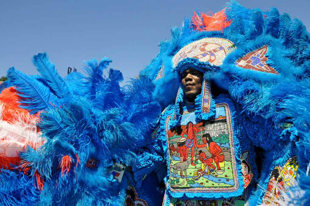 A Mardi Gras Indian displays the fruits of his labor.