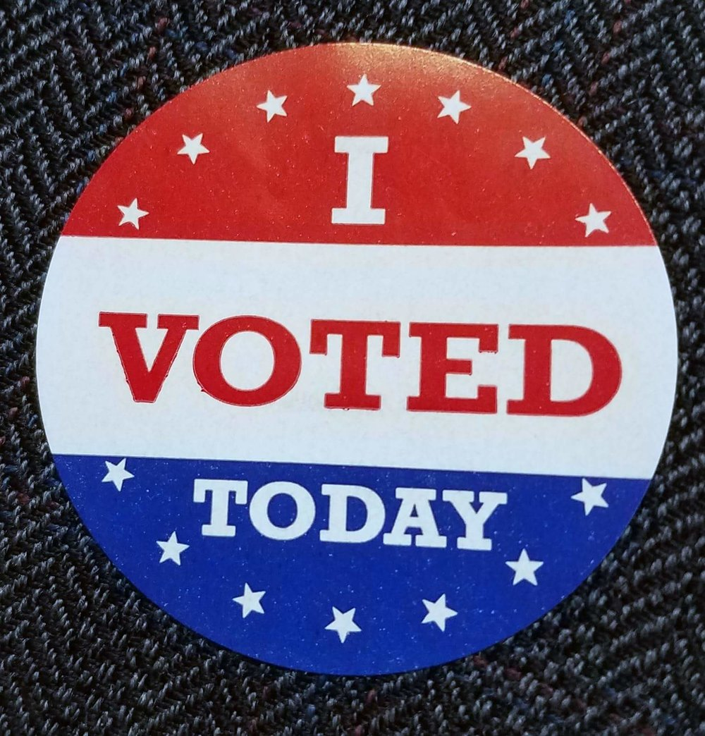 "Red, white, and blue round sticker with text ""I voted today"" on navy background."