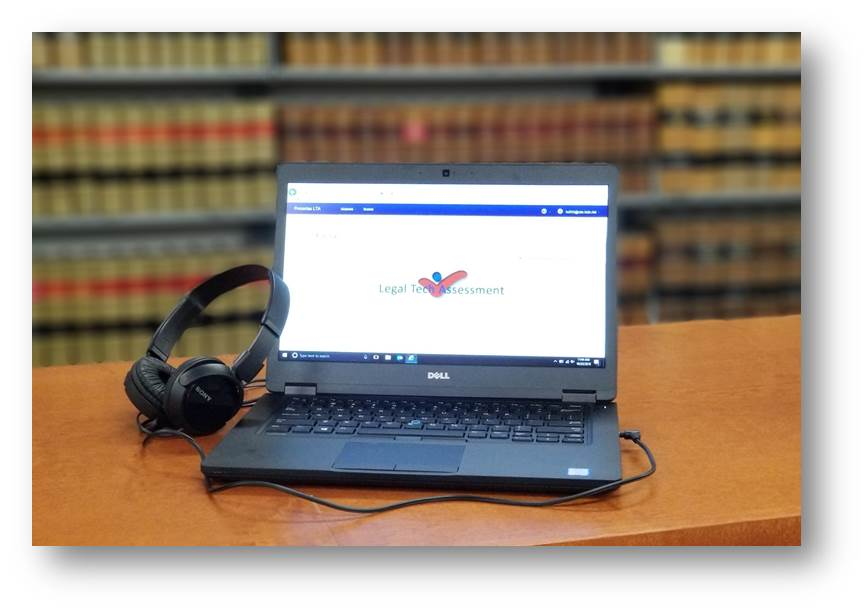 Harris County Law Library training laptop with Legal Tech Assessment logo