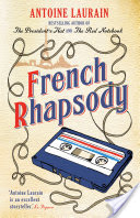 Susie is reading French Rhapsody by Antoine Laurain