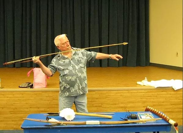 Charles demonstrating the use of Calusa weaponry at a previous lecture