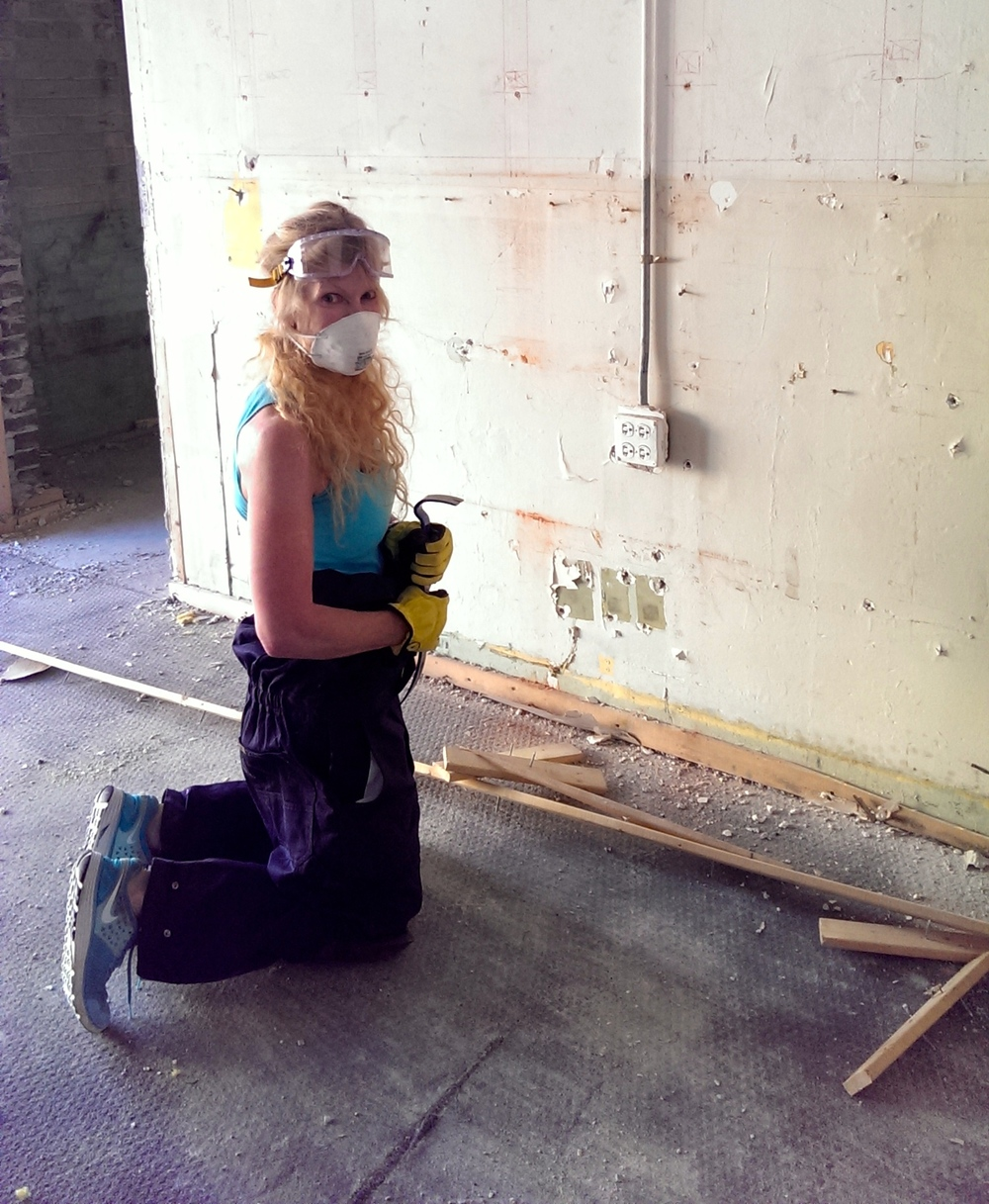 And Laura - looking both safe and cute while ripping off old baseboards - not an easy task.