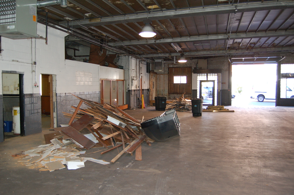 Here's the space on day 1 - most of the interior walls on the left (which is the right side of the building when facing from Broadway) will come out to make room for the taproom