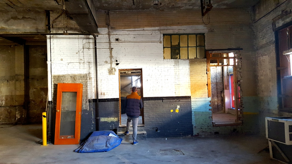 NOW:  And finally, here it is today! The brick walls are structural and will stay up as part of the taproom. We'll eventually fix the doors and window so they blend better with the wall, and we're hoping to have some sort of fun paint or mural on the brick