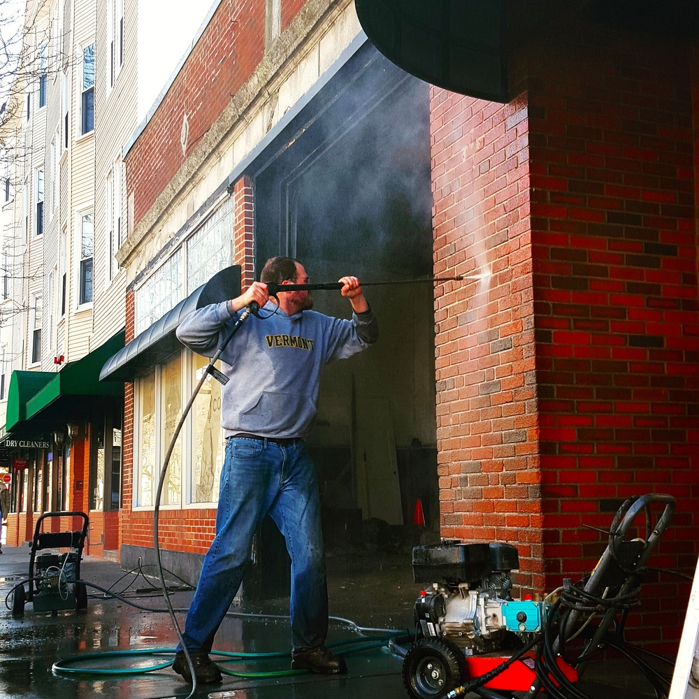 Tyler gave the front of the building a much needed power wash (now it's covered with concrete dust again, but it looked good for a day!)