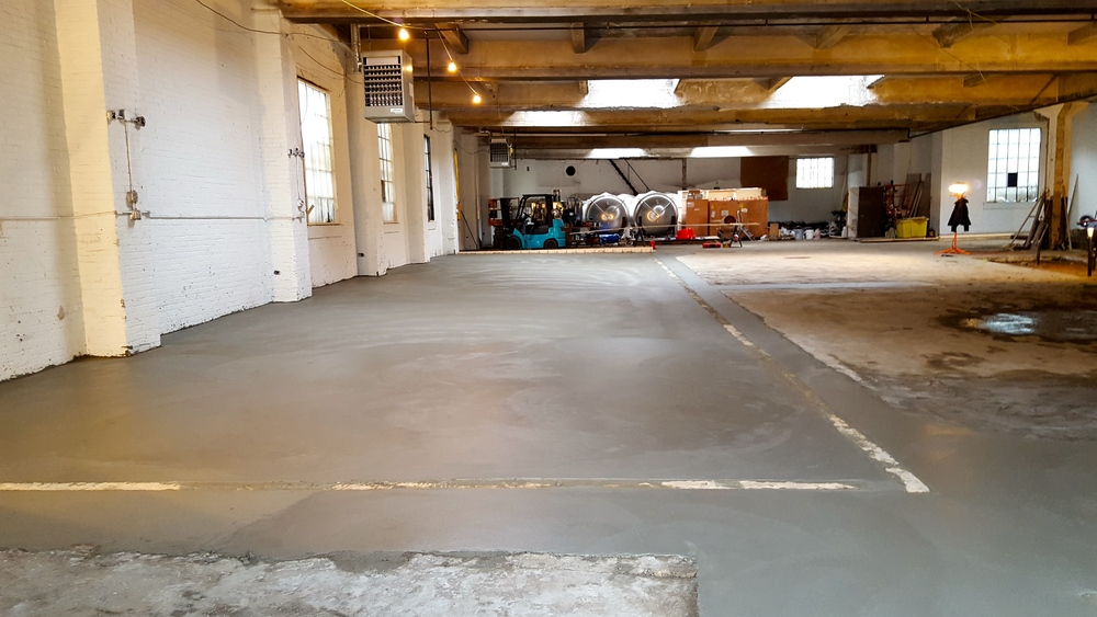I never thought I'd get so excited about concrete, but this new floor may truly be one of the most beautiful things I've ever seen. We'll seal it next week then stand the equipment up and start hooking it in shortly thereafter.