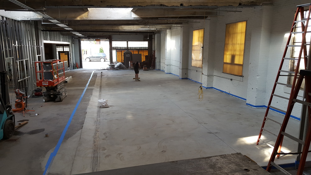 After waiting for the new concrete floor to cure, we taped everything off, swept ~60 times, and sealed the floor with five layers of a polyurethane coat to protect it from brewery wear and tear