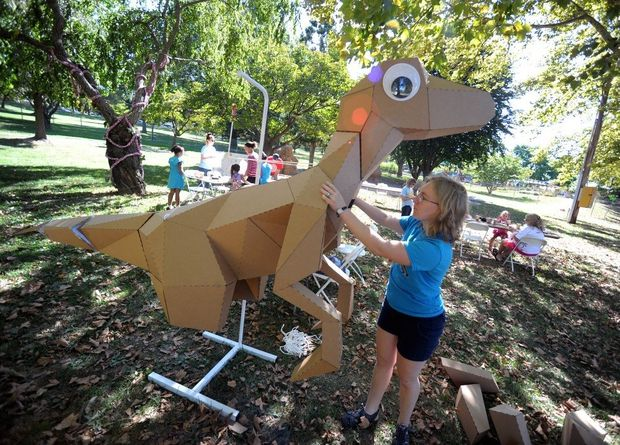 Lisa Glover, owner and creator of Kit Rex, an origami-inspired paper puzzle, assembles a large-scale version of her work during the first day of the Allentown ArtsFest at Cedar Beach Park on Sept. 12, 2014.