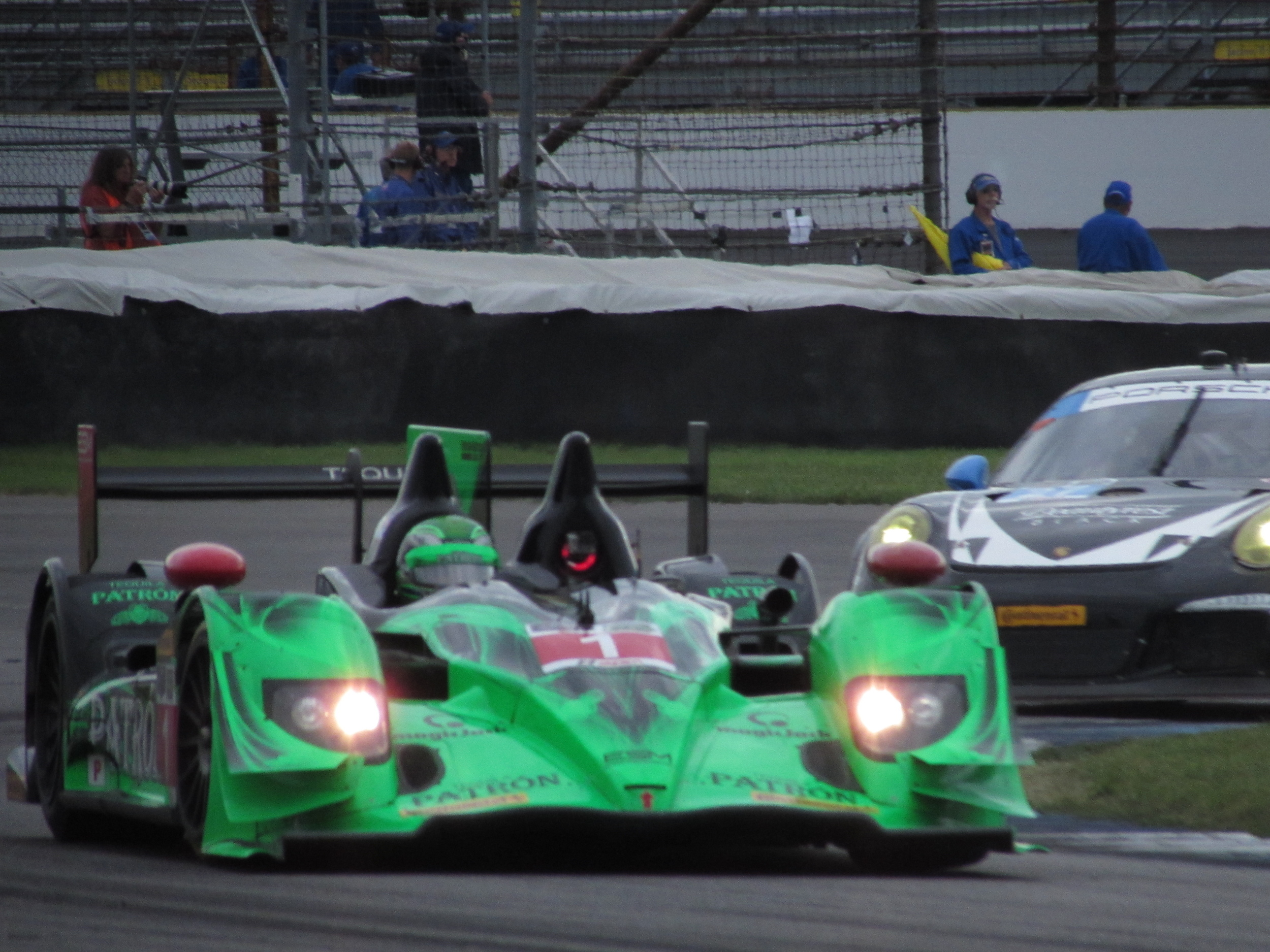 Extreme Speed Motorsports Honda Prototype accelerates out of Indianapolis road course T2, followed by the Dempsey Racing Porsche GT America 911.