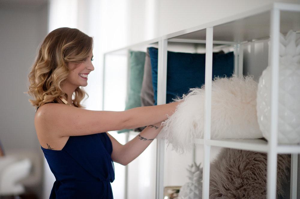 Designer Kelsey styling a bookcase (1).jpg