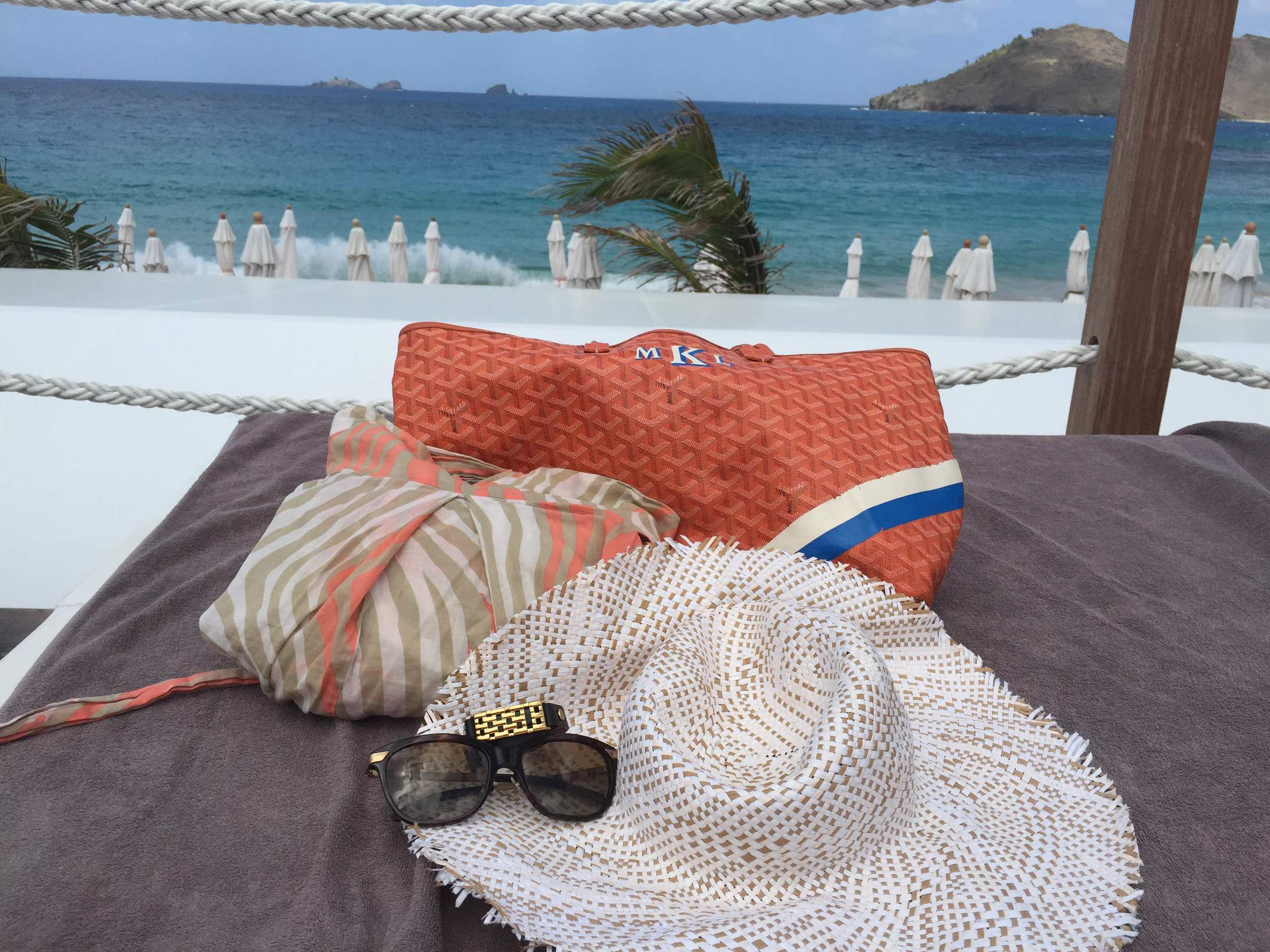 What to wear in St. Barths: DVF maxi dress cover up, Goyard St. Louis tote bag, Burberry sunglasses, Bezels & Bytes bracelet with Fitbit tracker inside, BCBG sunhat.
