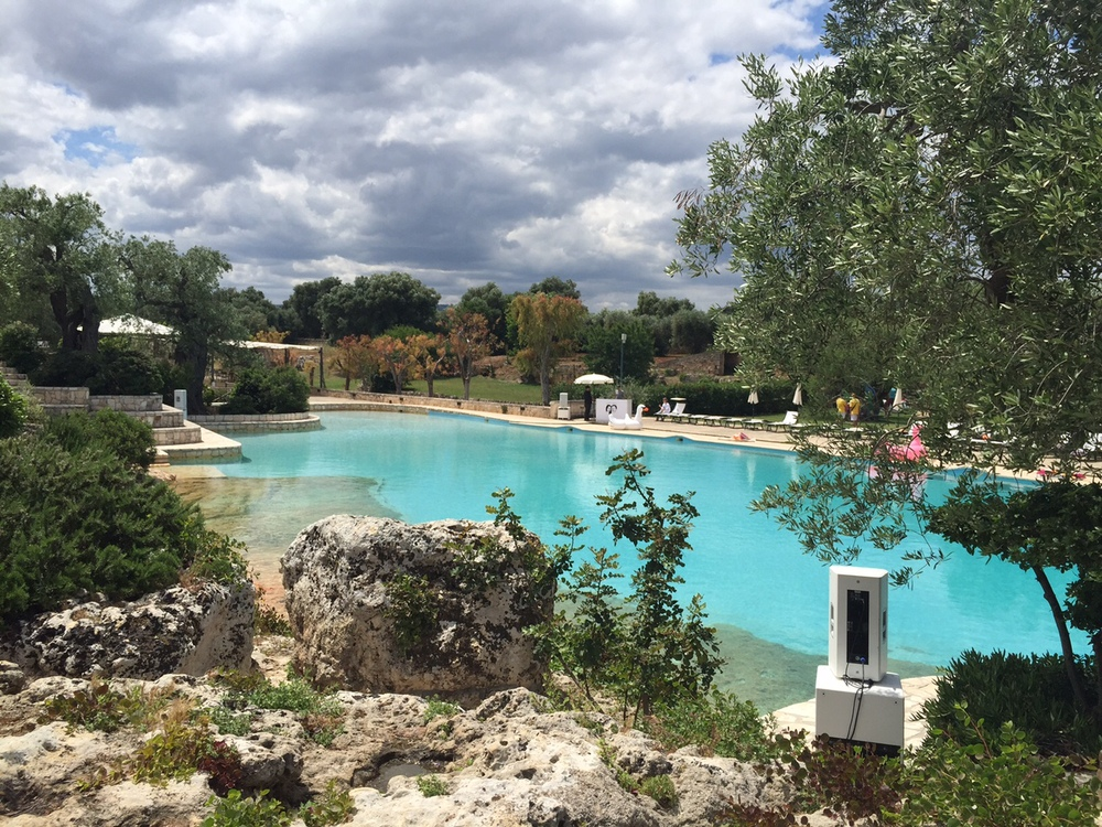 The bride and groom threw an awesome pool party at a local hotel, Masseria San Domenico in Puglia, Italy...complete with DJ, giant floaties, and stations of grilled meat and seafood, deserts, salads, and gelato.  This is not a bad setting to be reunited with fun old college friends!
